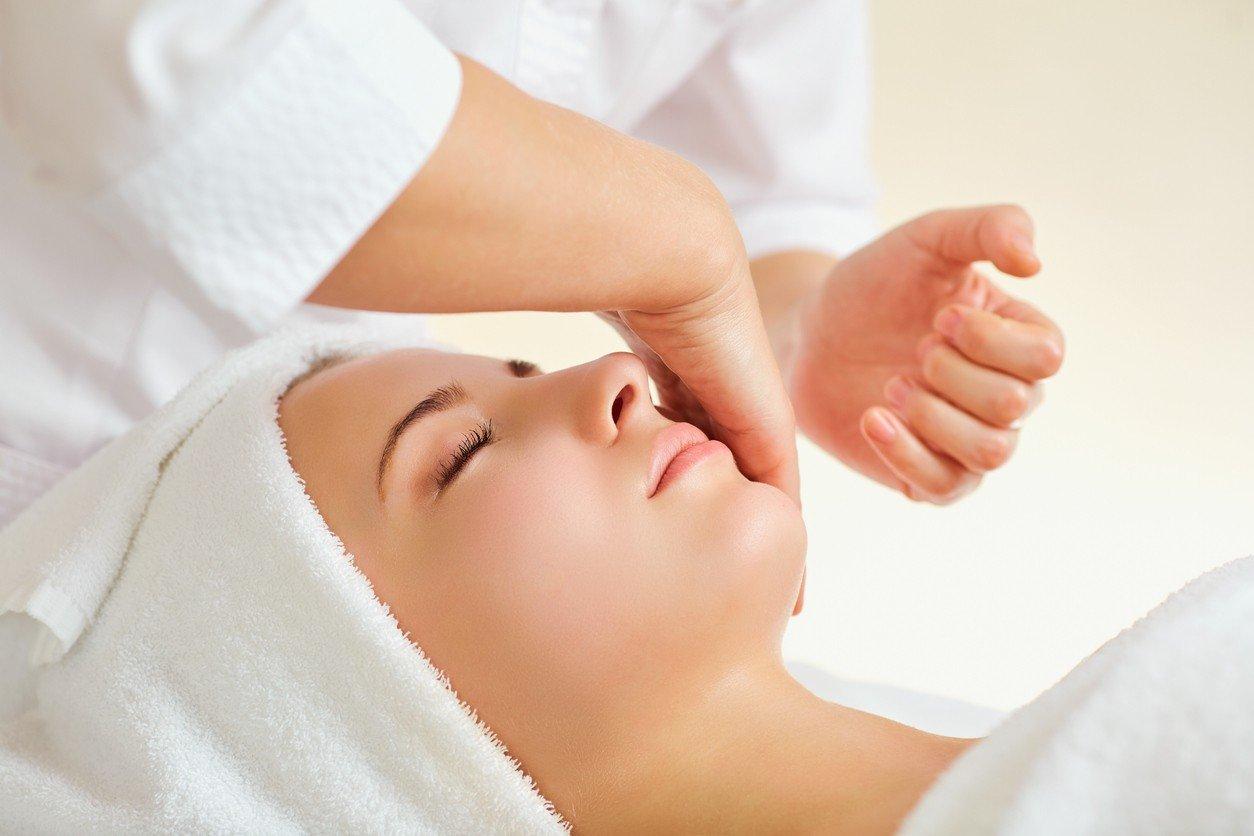 Beautiful woman at a facial massage at a spa salon